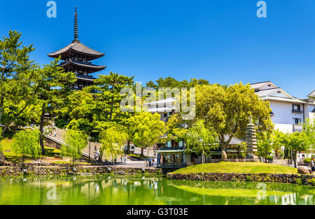 Goju-no-to five-storied pagoda above Sarusawa-ike Pond in Nara - Stock Photo