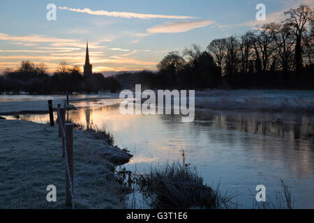 Burford church and River Windrush on frosty winter morning, Burford, Cotswolds, Oxfordshire, England, United Kingdom, - Stock Photo