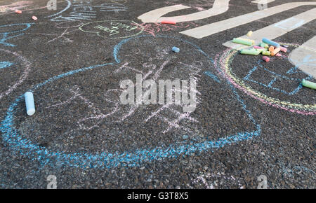 Chalk drawing on road tarmac of heart with Love Is Love #Orlando in tribute to the 2016 shootings. - Stock Photo