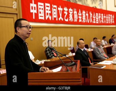 Beijing, China. 15th June, 2016. Pan Lusheng (L) speaks at the closing ceremony of the ninth national congress of - Stock Photo