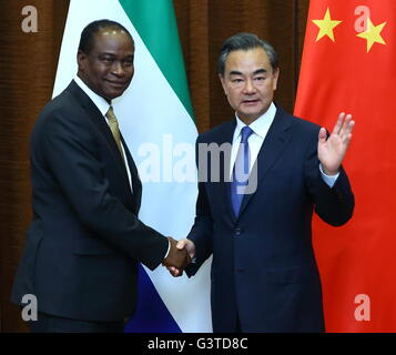 Beijing, China. 15th June, 2016. Chinese Foreign Minister Wang Yi shakes hands with Sierra Leone's Foreign Minister - Stock Photo