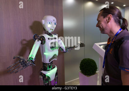 St. Petersburg, Russia. 15th June, 2016. A man talks to an Android in Saint-Petersburg, Russia, on Jun. 15, 2016. - Stock Photo