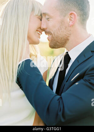 Sweden, Groom and bride kissing - Stock Photo