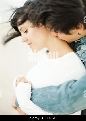 Spain, Valencia, Man embracing and kissing girlfriend - Stock Photo