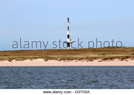 radar tower and accomodation huts of wilhelmshaven water and shipping authority, minsener oog, friesland district, - Stock Photo