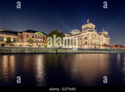 Germany, Berlin, Spreebogenpark, Reichstag buildings, Illuminated buildings at night - Stock Photo