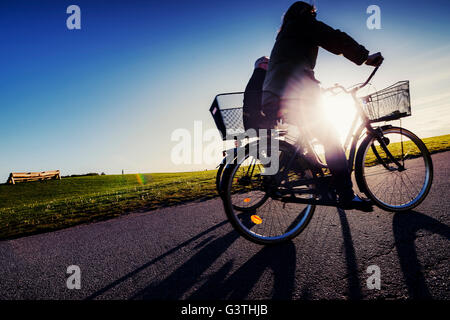 Sweden, Skane, Malmo, Ribersborg, Side-view of cyclists in park - Stock Photo