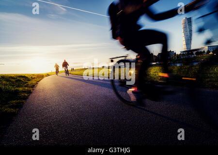 Sweden, Skane, Malmo, Ribersborg, Low-section of cyclist - Stock Photo