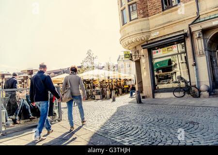 Sweden, Skane, Malmo, Lilla torg, Senior couple holding handsi n town square - Stock Photo