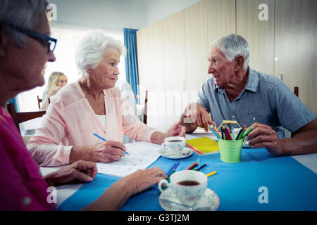 Group of seniors drawing and interacting - Stock Photo