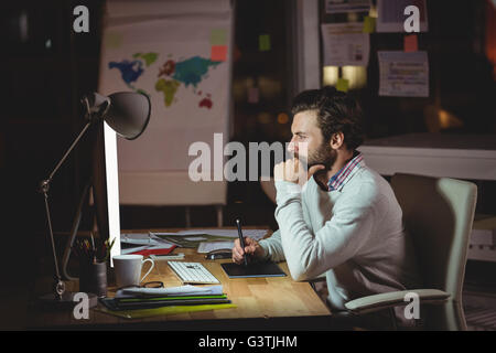 Concentrated man front of computer - Stock Photo