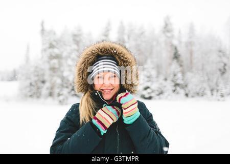 Finland, Jyvaskyla, Saakoski, Portrait of young woman in winter coat - Stock Photo
