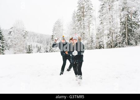 Finland, Jyvaskyla, Saakoski, Young couple having snowball fight