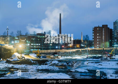 Finland, Pirkanmaa, Tampere, Construction site in winter at dusk - Stock Photo