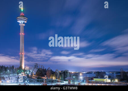 Finland, Pirkanmaa, Tampere, Nasijarvi, Illuminated communications tower at night - Stock Photo