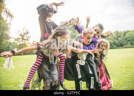 Children dressed as zombies for Halloween Night. - Stock Photo