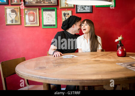 A young couple enjoying being with each other in a coffee shop in Manchester. - Stock Photo