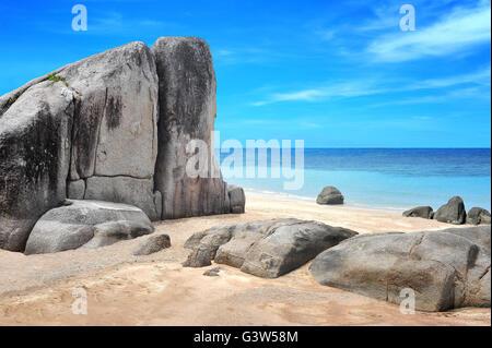 Idyllic beach with yellow sand and beautiful rocks - Stock Photo