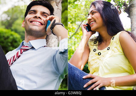 2 People Adult Man Adult Woman Business Man Comparison Gossip Mobile Phone Outdoors Smiling Talking - Stock Photo