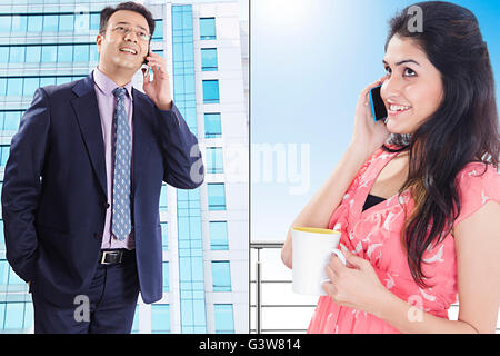 2 People Adult Man Adult Woman Business Man Digitally Enhanced Gossip Married Couples Mobile Phone Smiling Talking - Stock Photo
