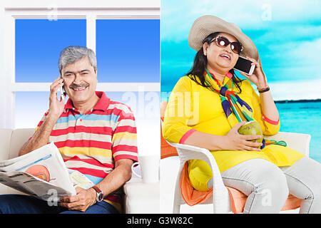 2 People Adult Man Adult Woman At Home Beach Digitally Enhanced Married Couples Mobile Phone Smiling Talking - Stock Photo