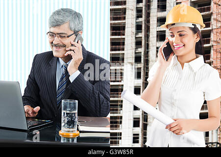 2 People Adult Man Adult Woman Communication Digitally Enhanced Employee Engineer Manager Mobile Phone Talking - Stock Photo
