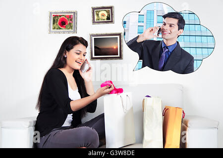2 People Adult Man Adult Woman At Home Businessman Married Couples Mobile Phone Shopping and Retail Smiling Talking - Stock Photo