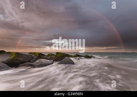 Hayling Island sunset in summer with a stunning rainbow - Stock Photo