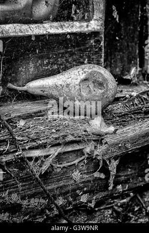 Rotting pear on a rotten wooden window sill - Stock Photo