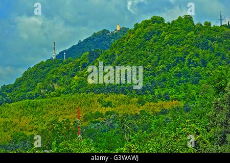 Panorama of the mountain ridge covered by dense vegetation near to the sea - Stock Photo