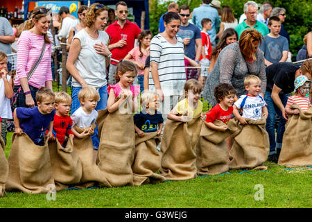 Children Race In A Traditional Sack Race At The Medieval Fair Of Abinger, Surrey, UK - Stock Photo
