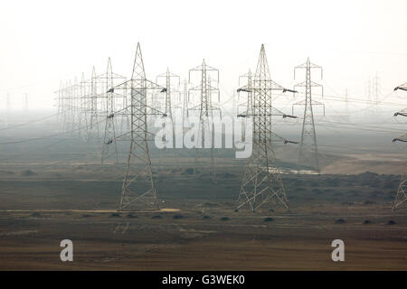 Power lines & pylons next to Suez canal Egypt - Stock Photo