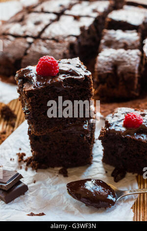 Homemade chocolate brownies with raspberry on the wooden background - Stock Photo