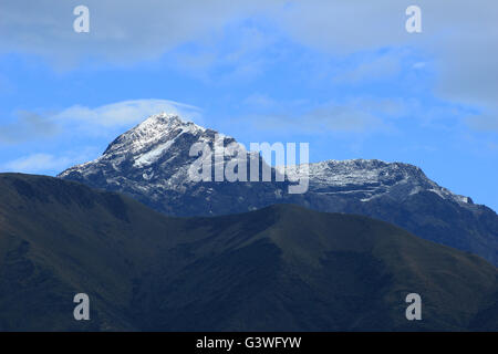 Snow on the summit of the volcano, Mount Cotacachi, in the Andes Mountains near Cotacachi, Ecuador - Stock Photo