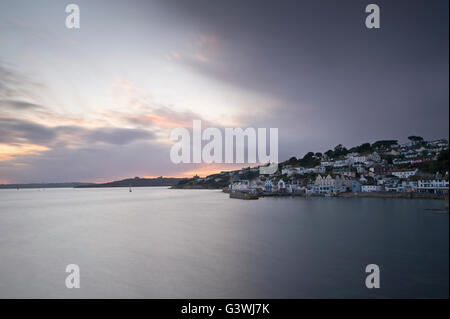 St.Mawes Harbour with dramatic sunset clouds - Stock Photo