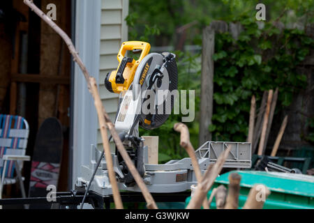 Dewalt 12' miter saw on jobsite. - Stock Photo