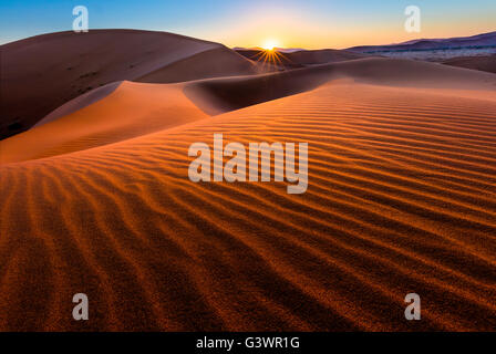 Sossusvlei is a salt and clay pan surrounded by high red dunes, located in the in the Namib-Naukluft National Park - Stock Photo