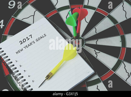 2017 new year's goals on notepad with darts on bulls eye, retro style - Stock Photo