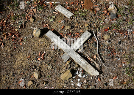 broken cross on the ground in guyra cemetary in new england new south wales australia - Stock Photo