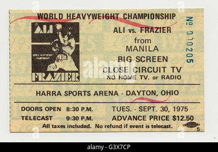A 1975 ticket stub to a closed circuit TV viewing of the THRILLA IN MANILA boxing match between Muhammad Ali & Joe - Stock Photo