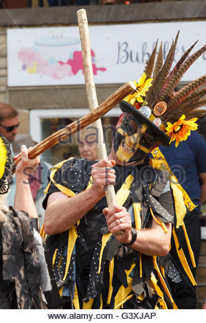Poacher Morris ( Border Morris dancing ) performing at Holmfirth Festival of Folk Holmfirth West Yorkshire England - Stock Photo