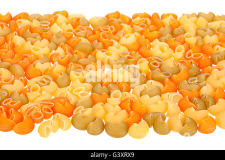 Multicolor dry swirl pasta isolated on white - Stock Photo