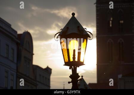 Lantern in the market square of Wismar, Mecklenburg-Western Pomerania - Stock Photo