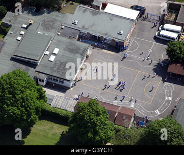 aerial view of a school playground with children playing, England, UK - Stock Photo
