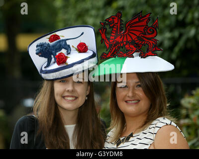 Racegoers Emma Smith-Lett (left) supporting England and Hetty Kelly, supporting Wales, during day three of Royal - Stock Photo