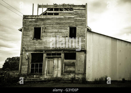 The Death Of Small Town America. Abandoned old wooden general store front with a crumbling façade. - Stock Photo