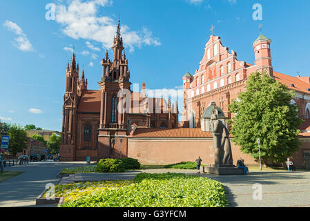 VILNIUS, LITHUANIA - JUNE 7, 2016: St. Anne's Church and Saints Francis and Bernardine Church and Adam Mitskevich - Stock Photo