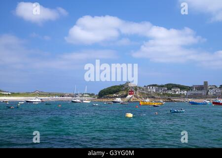 Lifeboat station and moored yachts off St Mary's, Isles of Scilly, Cornwall, England, UK, GB - Stock Photo