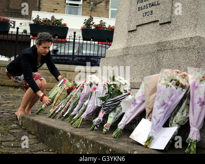MP Mary Creagh lays flowers in Birstall, West Yorkshire, following the death of Labour MP Jo Cox, who died after - Stock Photo