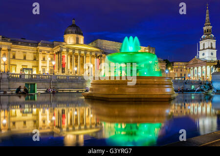 The National Gallery and Trafalgar Square at night in London - Stock Photo